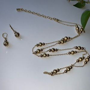 Gold toned long necklace with earrings to match